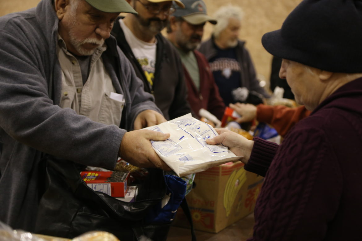 Food bank recipients are given items, such as dried mashed potatoes, canned vegetables and instant noodles. (Photo by Virginia Alvino Young/90.5 WESA)