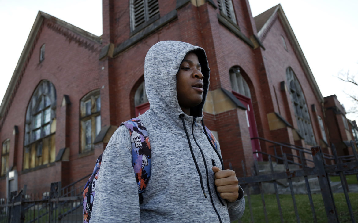 Maleeke Reid, 16, walks through Homewood on Feb. 27, 2018. (Photo by Ryan Loew/PublicSource)