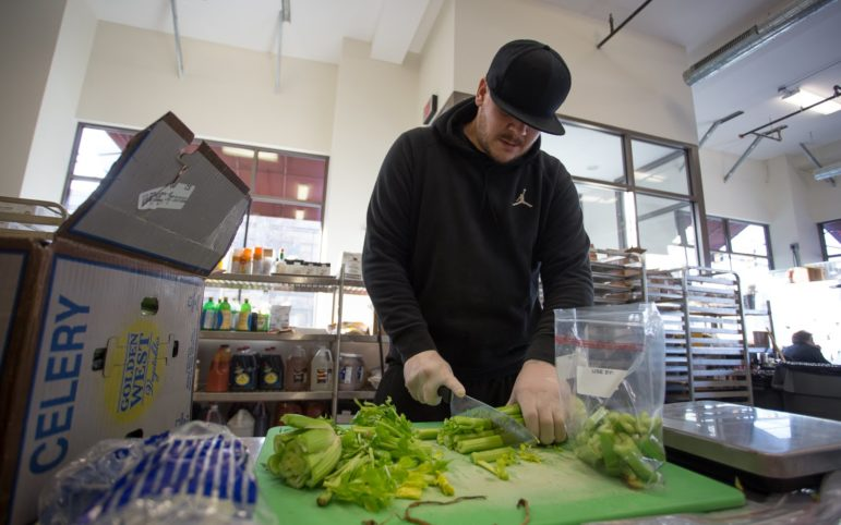 Ron Maruscak, 32, of Bellevue, cuts celery at Community Kitchen Pittsburgh in Hazelwood on Feb. 13. (Photo by John Hamilton/PublicSource)