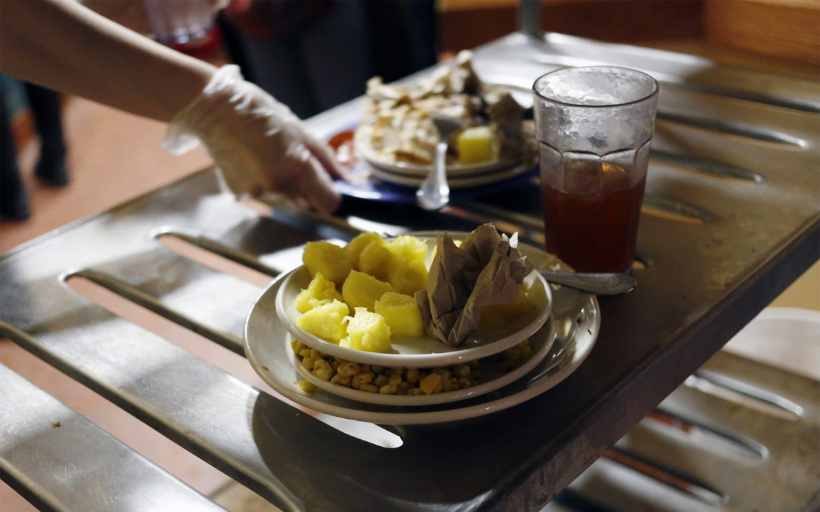 """Plates of food that will be collected for a """"waste audit"""" in the University of Pittsburgh's Market Central dining hall on Feb. 14, 2018. (Photo by Ryan Loew/PublicSource)"""