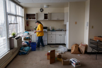"""Vivian Campbell works to pack up the last remaining items in her apartment at Penn Plaza on March 30, 2017; she would move to her """"new"""" apartment at Mellon Orchards later that day. (Photo by Maranie Rae Staab/PublicSource)"""