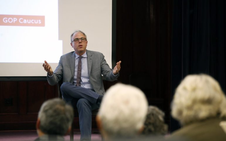 "David Daley, author of the book ""Ratf**ked: The True Story Behind the Secret Plan to Steal America's Democracy,"" speaks at the Carnegie Library of Pittsburgh's Homewood branch on April 11, 2018. (Photo by Ryan Loew/PublicSource)"