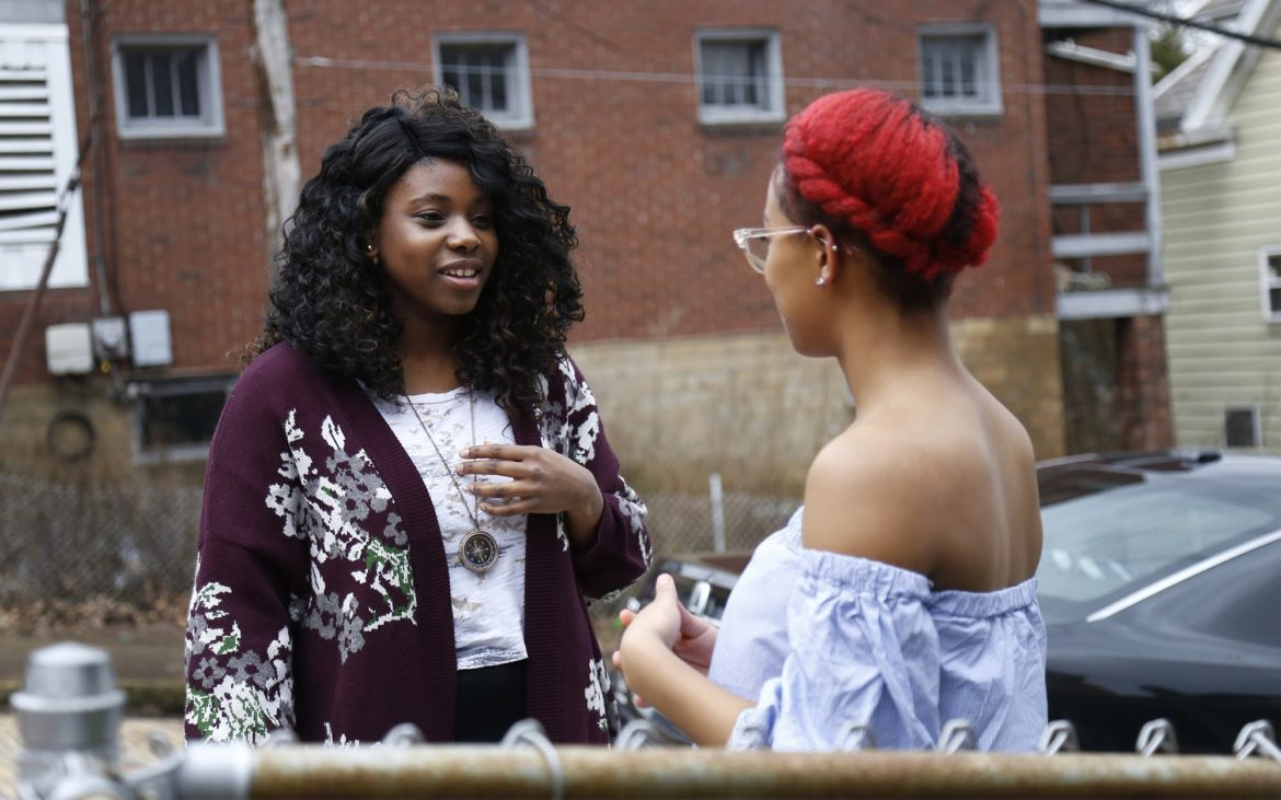 Hannah Watkins (left) talks with friend Donna Shouman in Wilkinsburg.(Photo by Ryan Loew/PublicSource)
