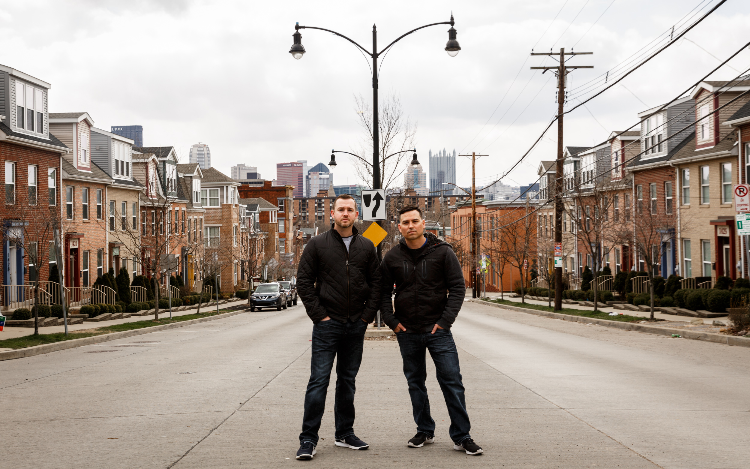 Husbands Jeff Brizek (left) and Craig Reinhard on the street in front of their home on Federal Street. They moved to the North Side because of its prime location. (Photo by Maranie Rae Staab/PublicSource)