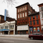 The nearly 150-year-old buildings at 4, 6 and 8 W. North Ave., seen here to the right of the Garden Theater on the North Side, once thrived with activity. Today, they sit vacant. The Garden Theater building also has a lengthy history and is undergoing a historical redevelopment. (Photo by Maranie Rae Staab/PublicSource)