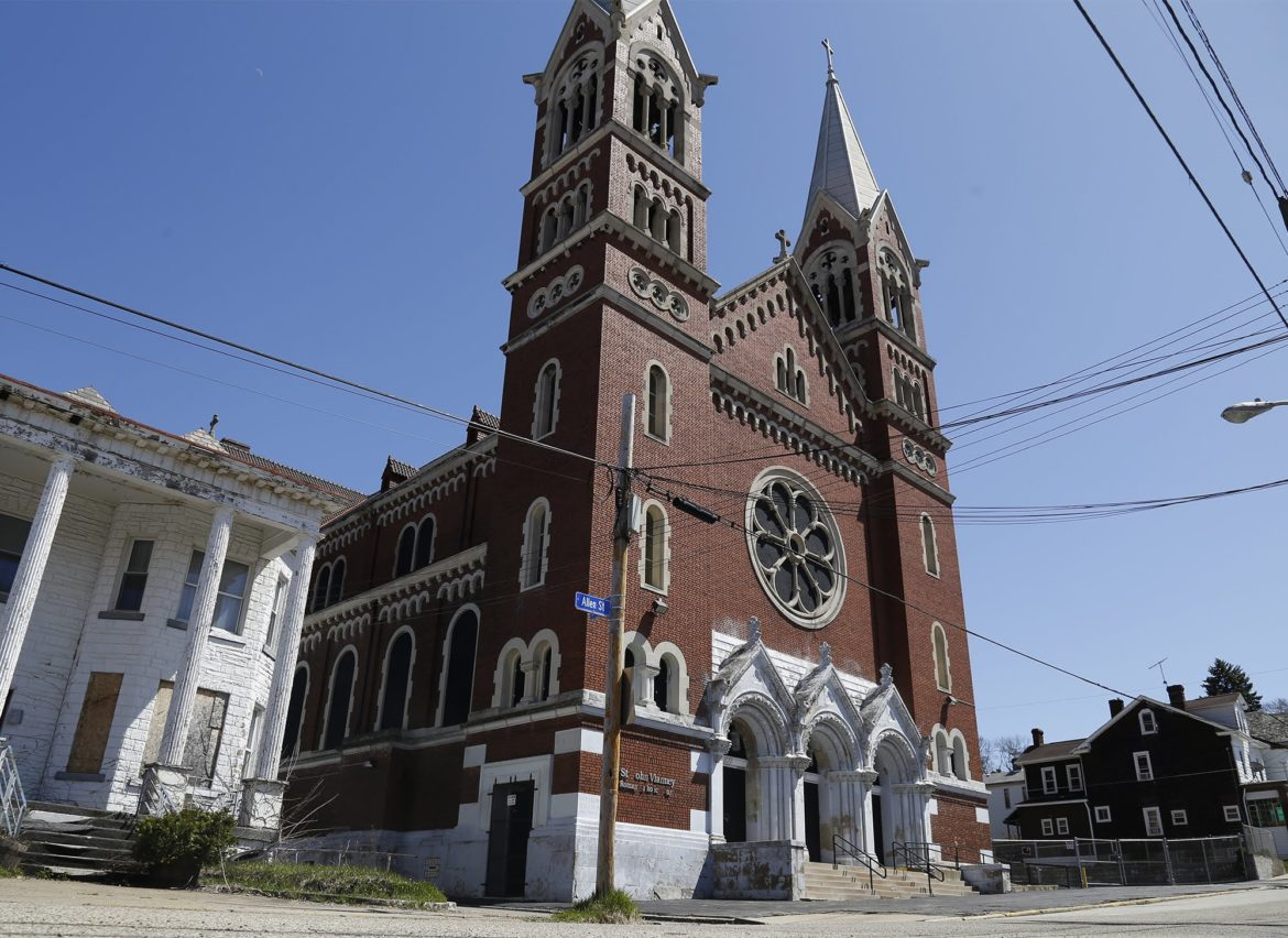 In January 2016, the Catholic Diocese of Pittsburgh announced that St. John Vianney parish would be dissolved. Now the diocese opposes a bid to give the building historic designation. (Photo by Ryan Loew/PublicSource)