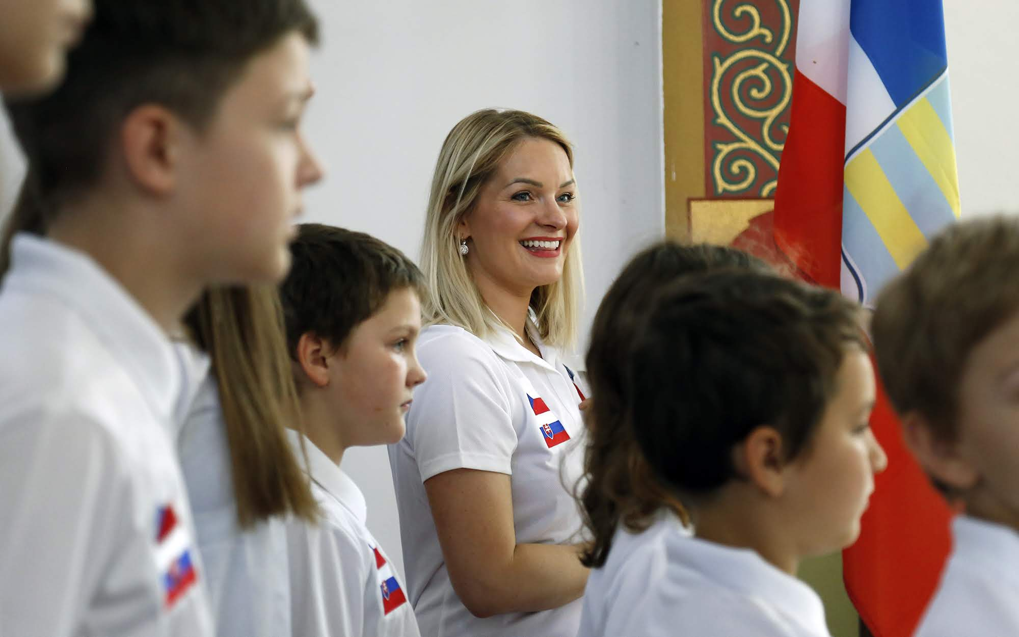 Alice Zdrale, director of the the Czech and Slovak School of Pittsburgh, helps lead students as the rehearse singing the Czech national anthem. (Photo by Ryan Loew/PublicSource)