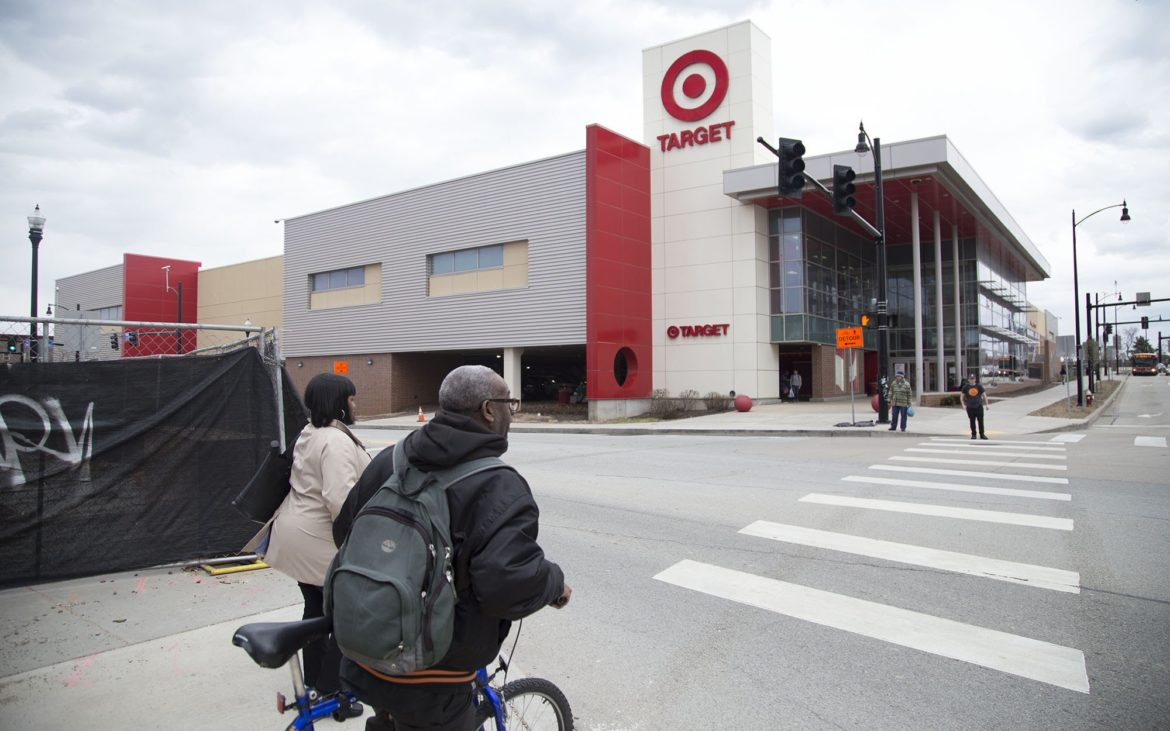 People walk at the intersection of Penn and Centre avenues near Target in East Liberty. (Photo by Chloe Jakiela/PublicSource)