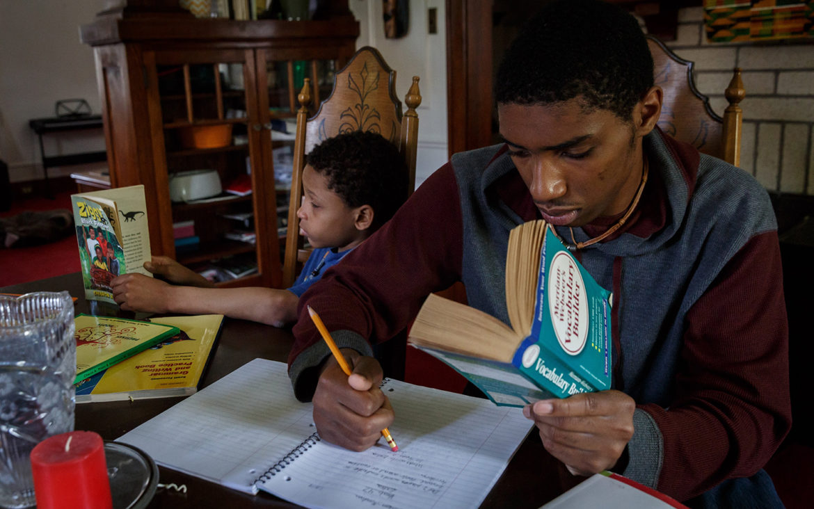 Jair (right) and Phillip Mendoza study at their home in Sheridan on May 9, 2018. Both are homeschooled by their mother, Muffy. (Photo by Maranie R. Staab/PublicSource)