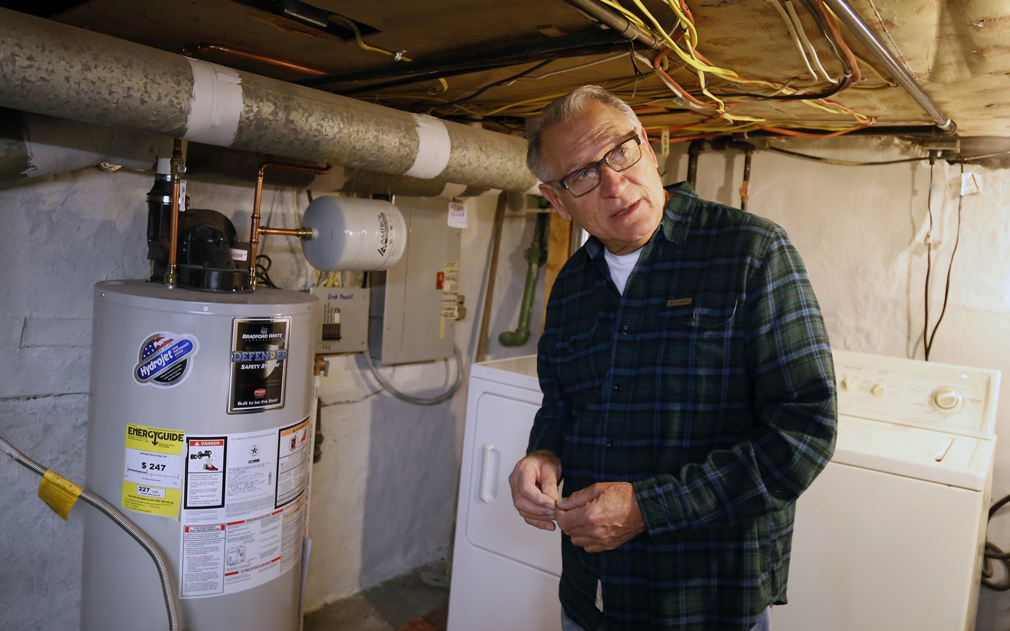 The Pittsburgh nonprofit Conservation Consultants replaced Angelo Norelli's water heater as part of the Grassroots Green Homes program. (Photo by Ryan Loew/PublicSource)