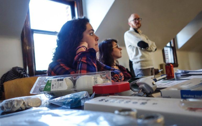 Eva Resnick-Day waits to show off the tools given away as part of the Grassroots Green Homes program at the March 22, 2018 meeting of Operation Better Block at the Homewood Branch of the Carnegie Library. (Photo by Oliver Morrison/PublicSource)