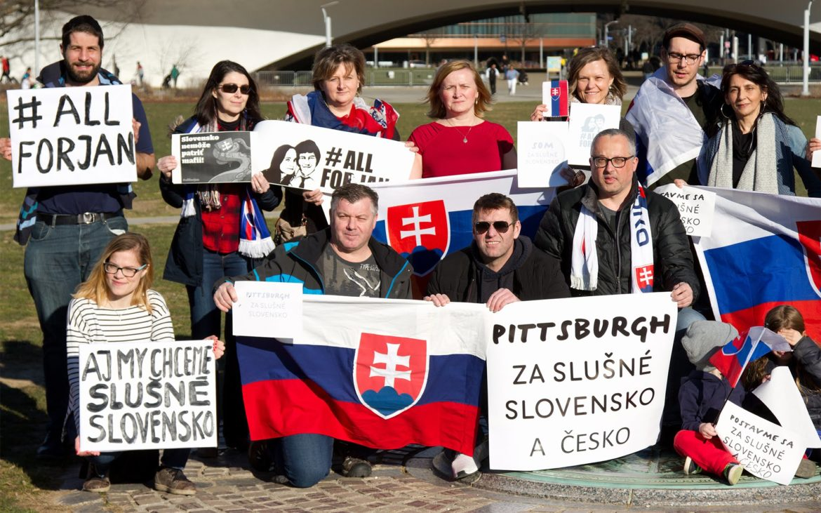 "In March, about 25 Slovak and Czech expatriates, some with their American-born children, participated in a protest at Point State Park over concerns about government corruption in the countries that were once combined as Czechoslovakia. The protest sign held by many said, ""Pittsburgh for a decent Slovakia and Czech Republic."" Another sign said, ""We don't want Slovakia to belong to the mafia."" (Photo by Jozef Kohl)"