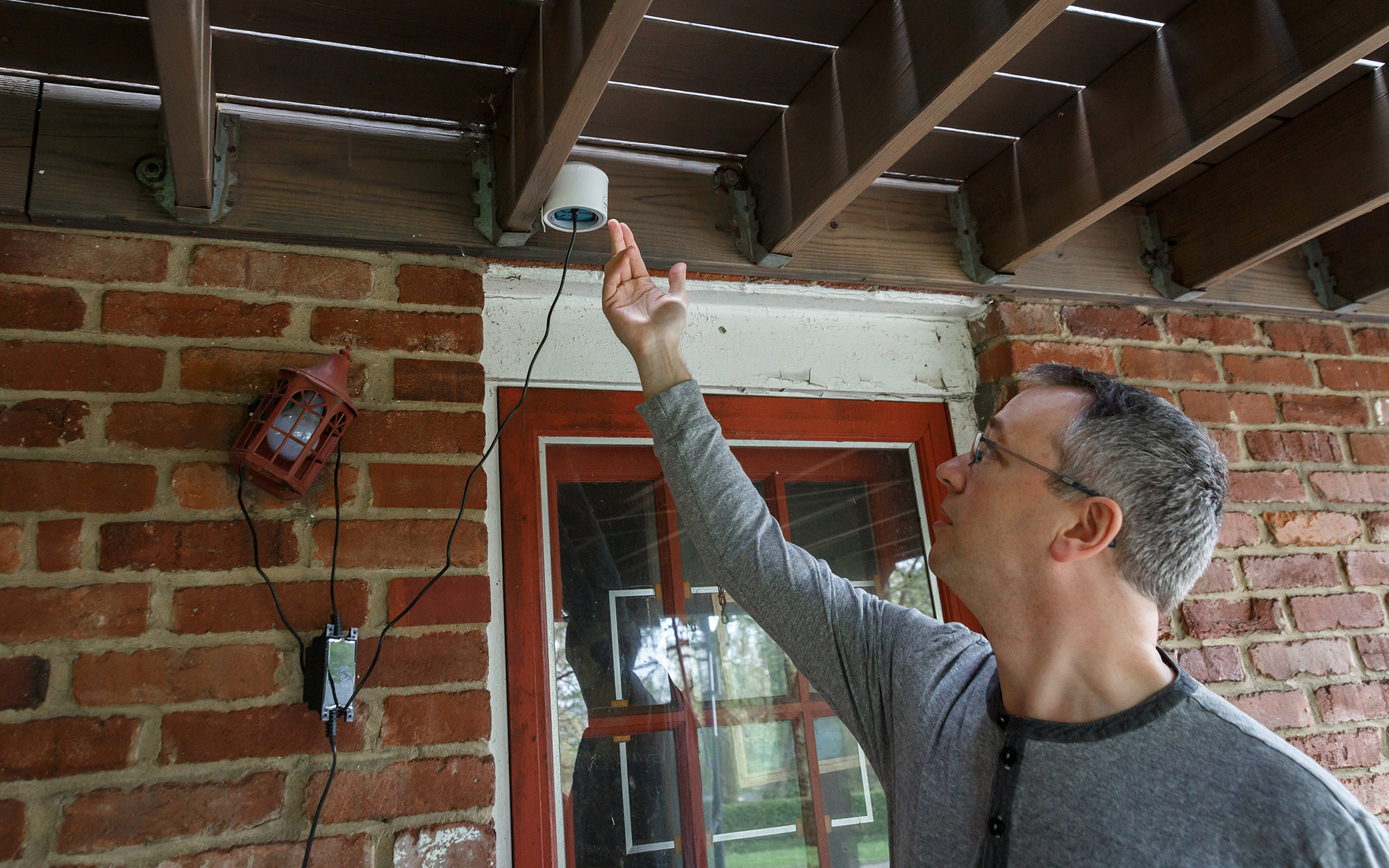 Greg Langmead is able to track the air quality surrounding his Edgewood home using a monitor set up behind his house. (Photo by Maranie Rae Staab/PublicSource)