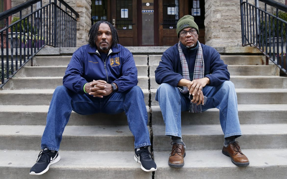 "Douglas Connor (left) and Khalid Raheem are organizers with the Committee for a Civilian Police Review Board of Allegheny County. ""It is more important than ever to have a countywide board,"" says Raheem. ""Due to gentrification, black people who previously lived in the city are now moving to the boroughs and we need to be able to address allegations of police brutality and misconduct at the borough level."" (Photo by Ryan Loew/PublicSource)"