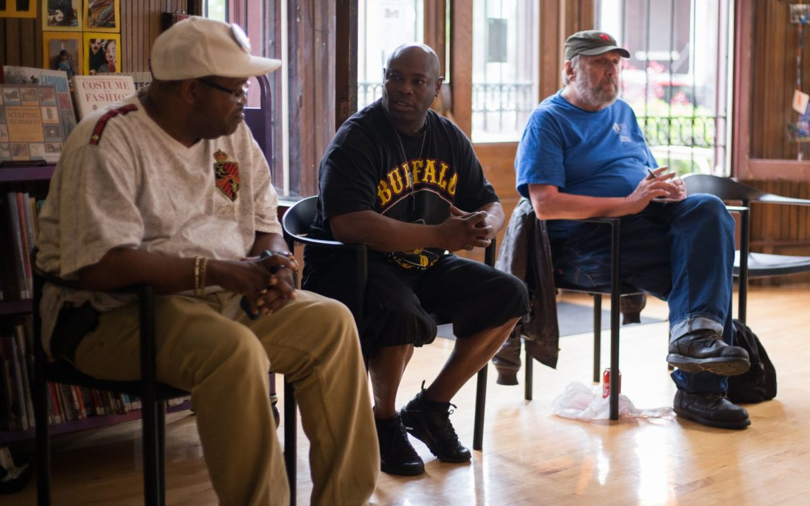 Residents discuss their encounters with various Allegheny county police departments at a meeting diccussing a county-wide police review board at Braddock library on May 16. (Photo by John Hamilton/PublicSource)