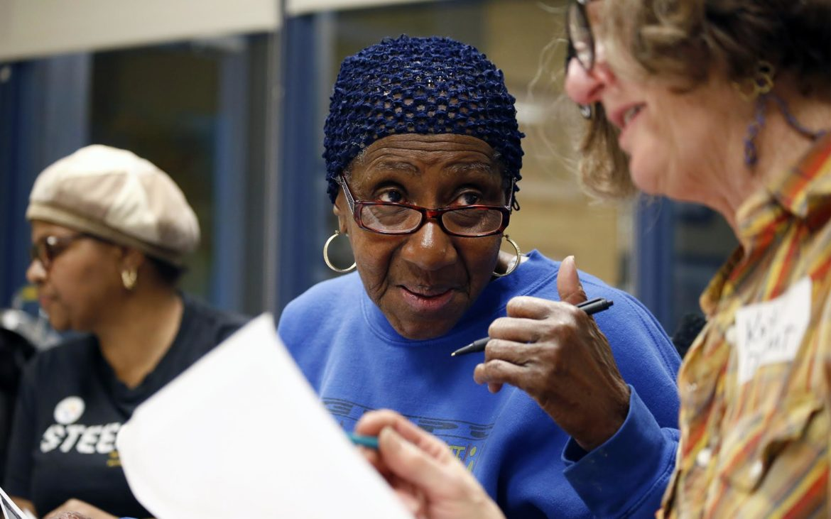 Betty Lane talks with Katy DeMent, of Swissvale, at a Feb. 23 planning meeting for the African Healing Garden. (Photo by Ryan Loew/PublicSource)