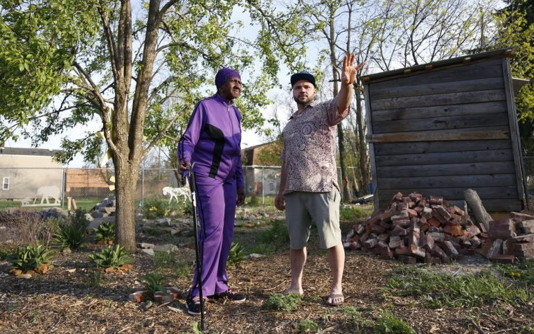 Betty Lane and Ben Ledewitz look out over the African Healing Garden in Larimer. (Photo by Ryan Loew/PublicSource)