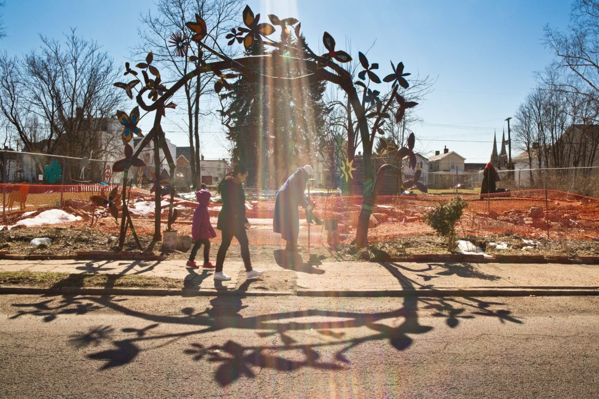 Seen here in late March, the arch to the African Healing Garden in Larimer is made out of old gas lines twisted into the shape of a flowering tree. (Photo by Heather Mull/PublicSource)