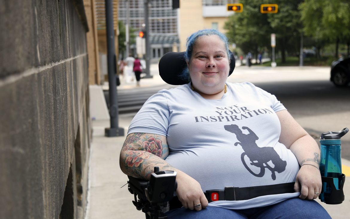 """I'd give the city six out of 10, pretty good but not perfect,"" says Alisa Grishman, founder of Access Mob Pittsburgh, an accessibility advocacy group, and member of Peduto's advisory group for Complete Streets. (Photo by Ryan Loew/PublicSource)"