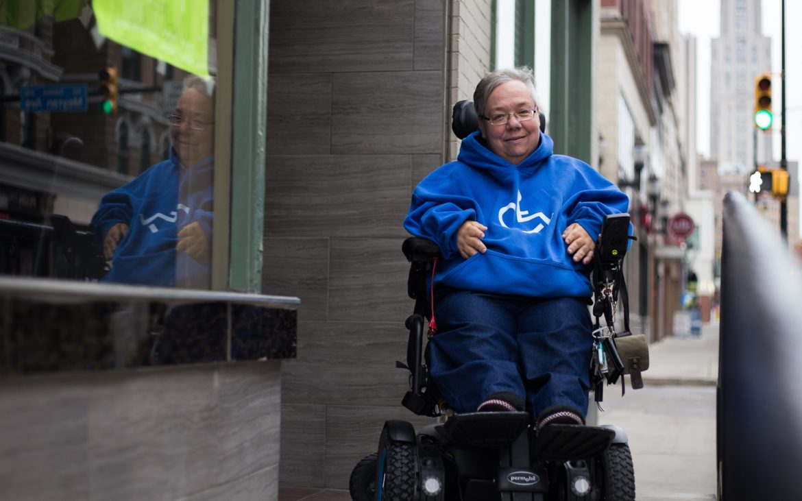 DJ Stemmler poses for a photo outside Noodle House in Oakland in November 2017. Stemmler said she ate in the restaurant the first day after the accessible ramp was installed. (Photo by John Hamilton / PublicSource)