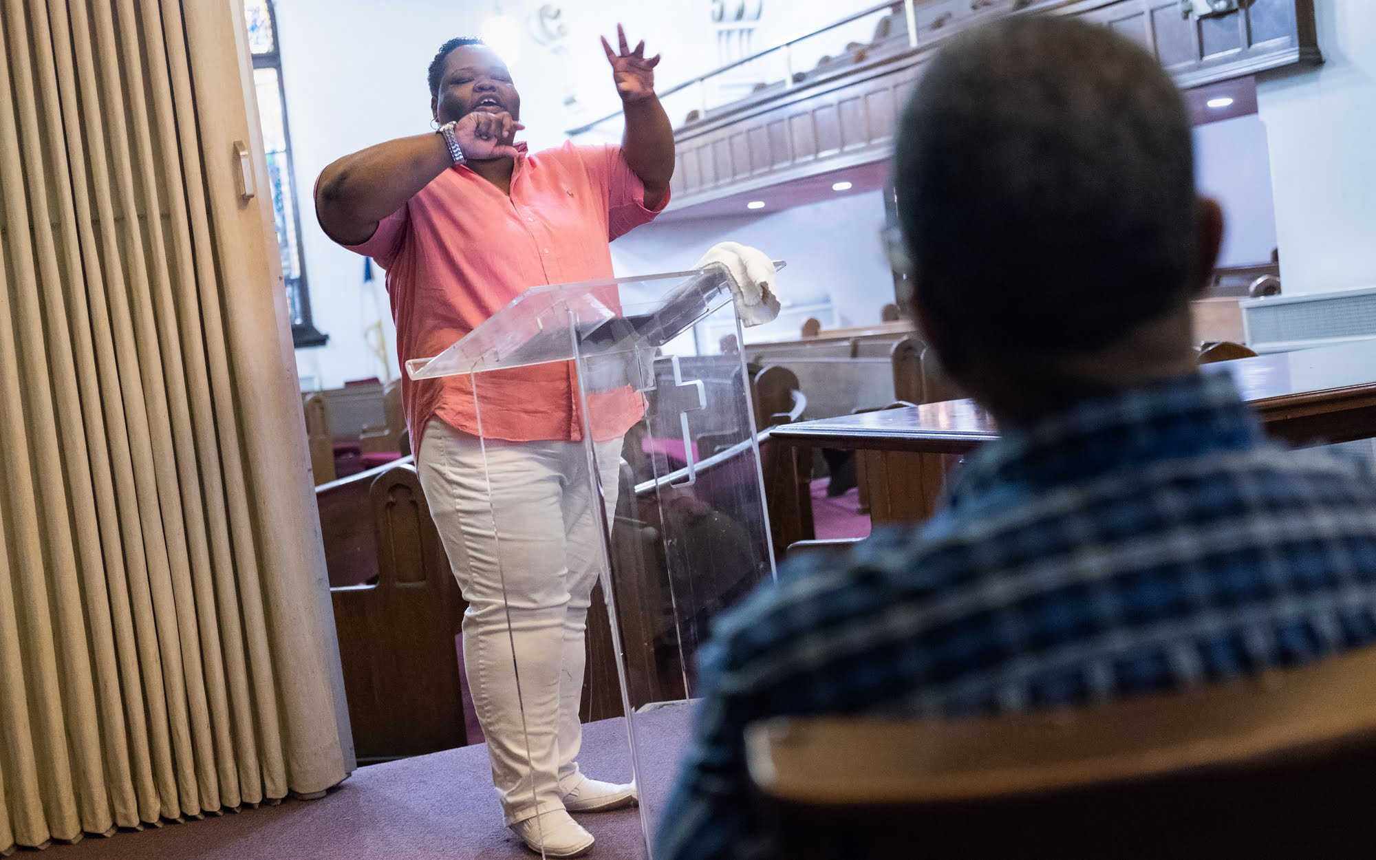 Rev. Shanea Leonard delivers the sermon during worship services. (Photo by Terry Clark/PublicSource)
