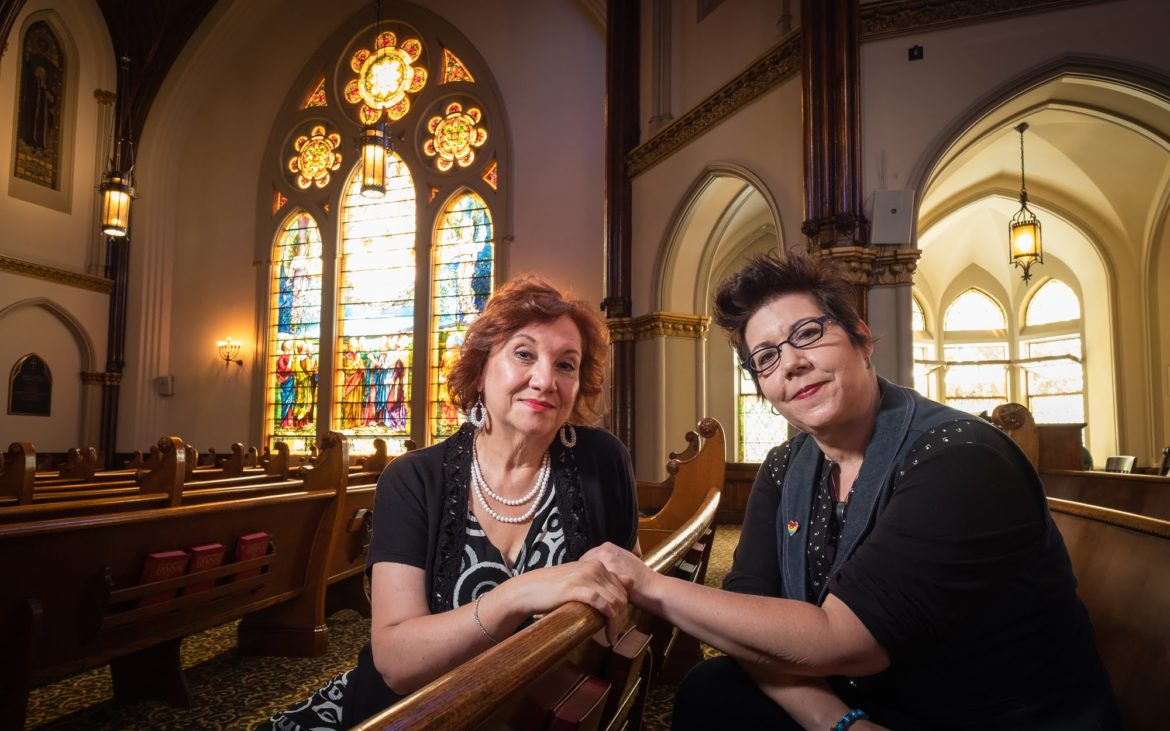 Yvonne Hudson and Lynette Asson in the sanctuary at Calvary United Methodist Church. (Photo by Terry Clark/PublicSource)