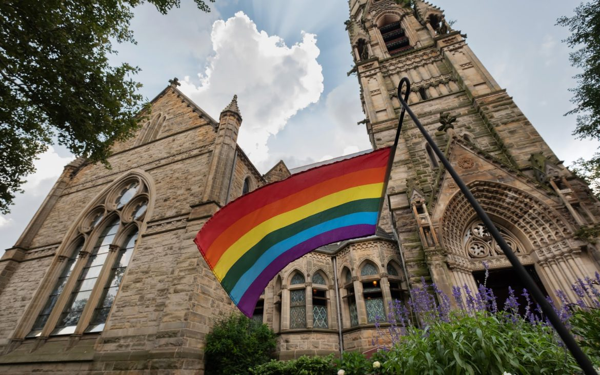 A rainbow flag outside of Calvary United Methodist Church on Pittsburgh's Northside. (Photo by Terry Clark/PublicSource)