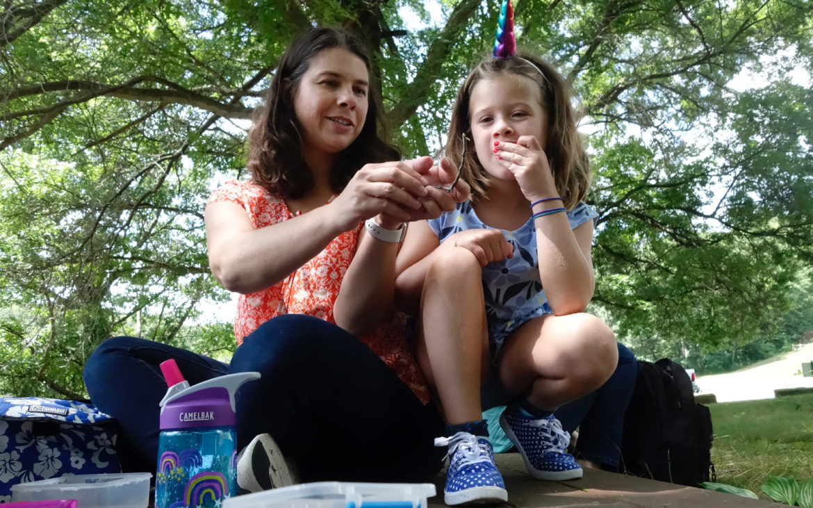 """""""Can you scooch so [the bug] doesn't climb on me?"""" Theodora Reese, 6, asked her mother, Phoebe, during a picnic at Ambridge Reservoir. (Photo by Oliver Morrison/PublicSource)"""