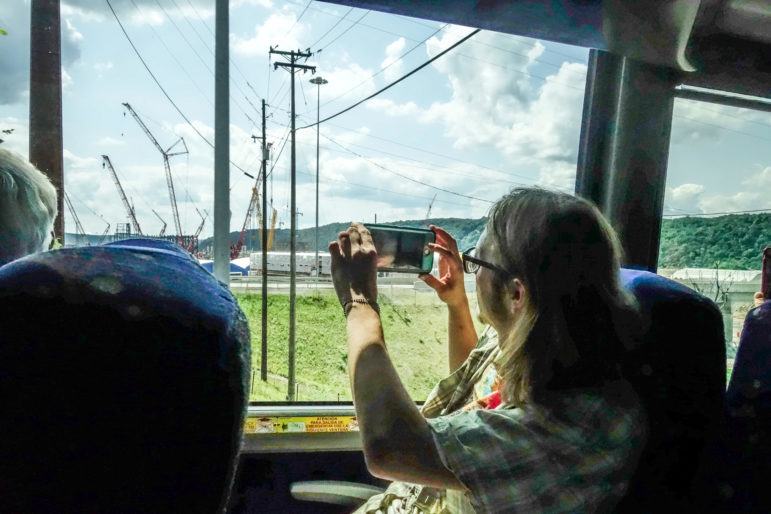 Donald Johnson took photos of the construction site at Shell's ethane cracker plant in Beaver County during an environmental bus tour with 50 local climate activists on Saturday. (Photo by Oliver Morrison/PublicSource)