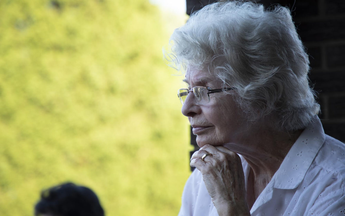 Jean Ripepi, 87, listens to plaintiffs speak at a meeting at her home in Monongahela, Pa. on August 9, 2018. (Kat Procyk/PublicSource)