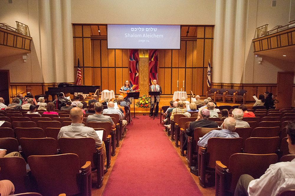 Worshippers gather at Rodef Shalom in Shadyside. (Photo by Jake Mysliwczyk/PublicSource)