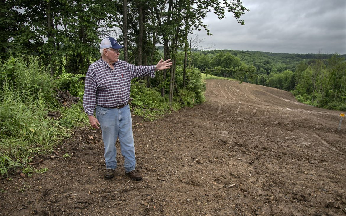 Cattle farmer Doug Bentrem stands at his property in Washington County where the Rover pipeline, a natural gas pipeline, has been buried. He's not satisfied with the way the contractor restored the terrain. (Photo by Teake Zuidema/PublicSource)