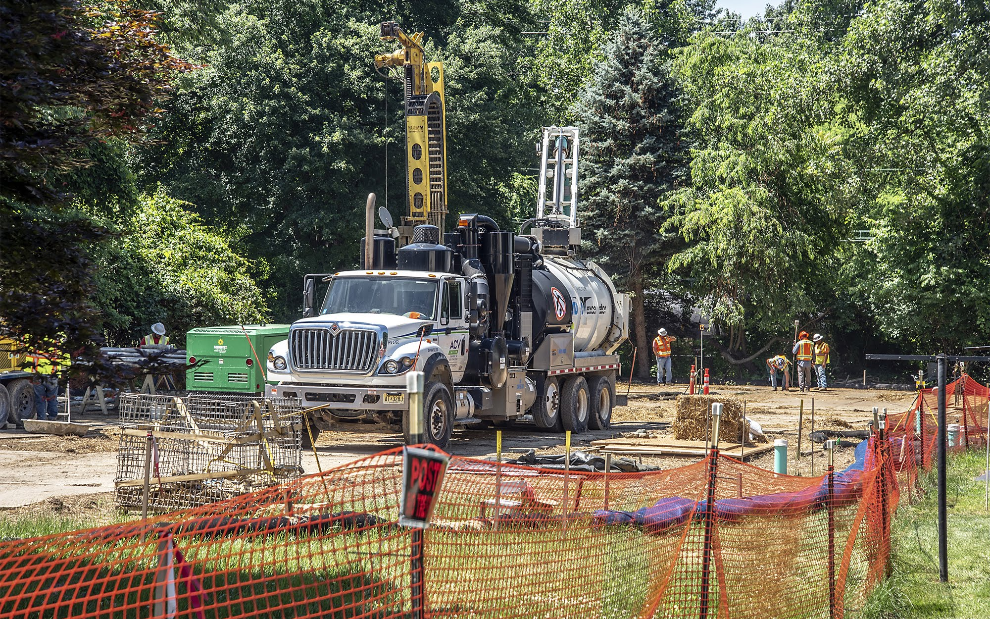 On June 25, 2018, contractors are working on a sinkhole at Lisa Drive in Exton, Pa. that was caused by drilling for the Mariner East 2 pipeline. It exposed an existing pipeline that had to be taken out of service. The contractor is trying to fill the hole with grout. (Photo by Teake Zuidema/PublicSource)