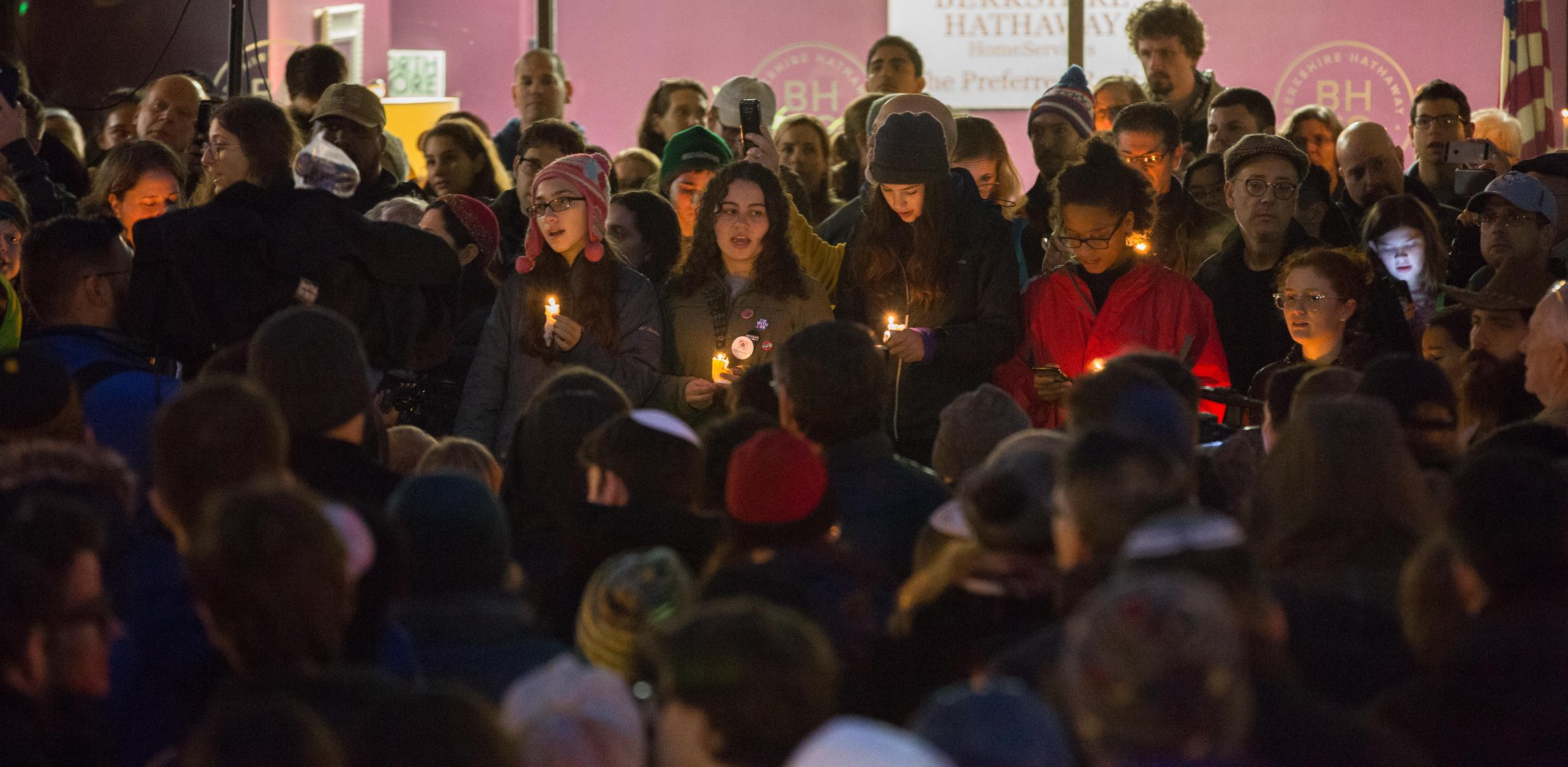 Hundreds of people attended a vigil organized by Taylor Allderdice High School students on Forbes and Murray Avenue Saturday night. (Photo by Heather Mull for PublicSource)