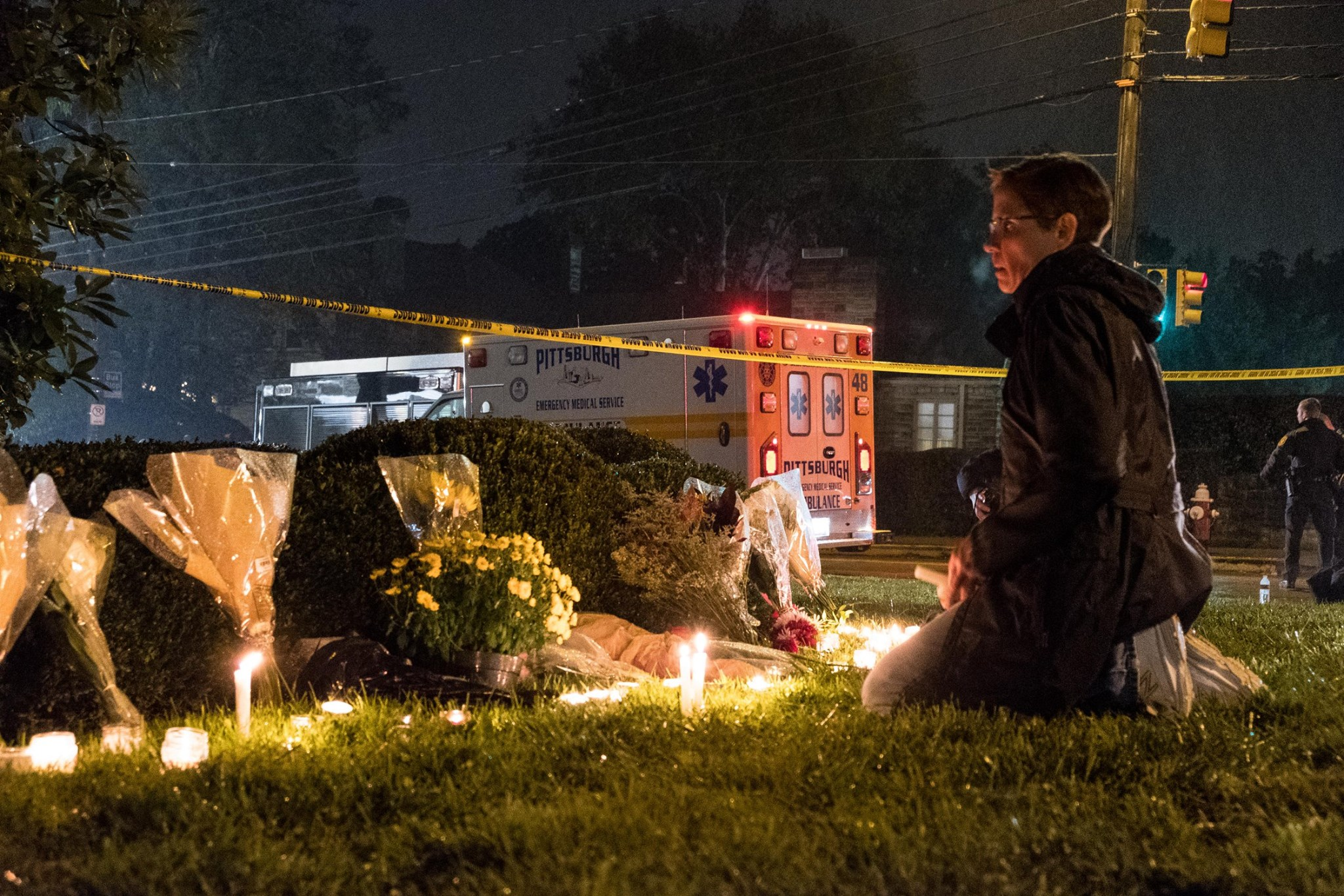 Victoria Wosher, who lives nears the Tree of Life Synagogue, lights candles and mourns at a makeshift shrine on Shady Avenue at 9:45 p.m. Saturday, twelve hours after the deadly attack on the Treet of Life synagogue in Squirrel Hill. anti-semitic gunman Robert Bowers, armed with an assault rifle and 3 handguns, entered the Tree of Life synagogue in Squirrel Hill. Wosher said she was deeply shaken and saddened by the shooting and loss of life.
