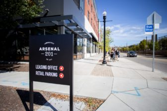 People walk along Butler Street past Arsenal 201, between 39th and 40th streets, in Lawrenceville. Arsenal 201 is one of the neighborhood's newest luxury developments.(Photo by John Altdorfer/PublicSource)