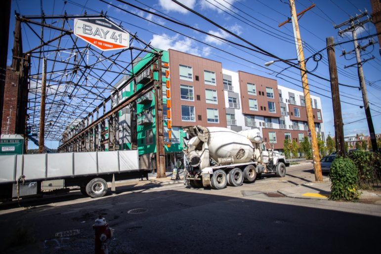 A cement truck passes by Foundry 41 at 41st and Willow streets in Lawrenceville. (Photo by John Altdorfer/PublicSource)