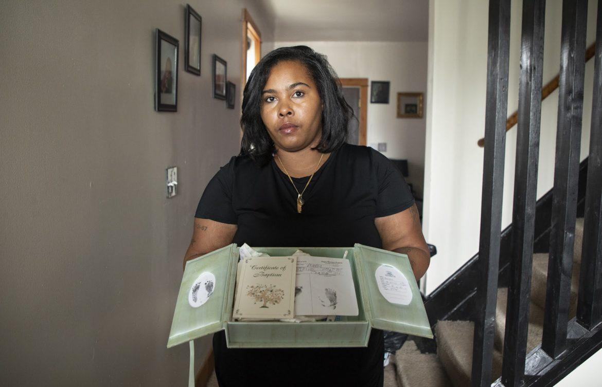 Carissa Ashby, 32, of Swissvale, holds the memory box for her deceased son, Dayon. An undiagnosed medical issue caused her to deliver her son stillborn at 30 weeks pregnant in 2005. She now speaks openly about the importance of all women understanding their health and their bodies, taking care of themselves, and being advocates for their own health when talking to health care professionals. (Photo by Kat Procyk/PublicSource)