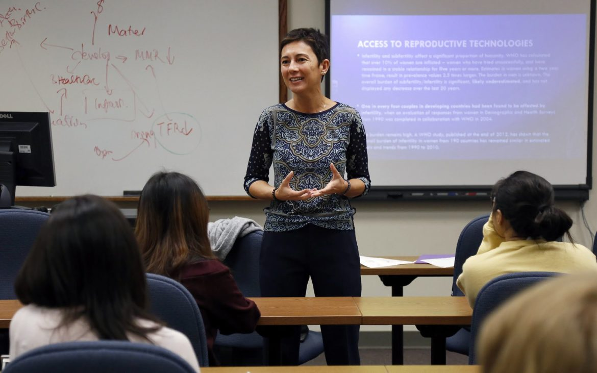 Müge Finkel, an assistant professor of international development at the University of Pittsburgh, teaches a gender and development class on Tuesday. (Photo by Ryan Loew/PublicSource)