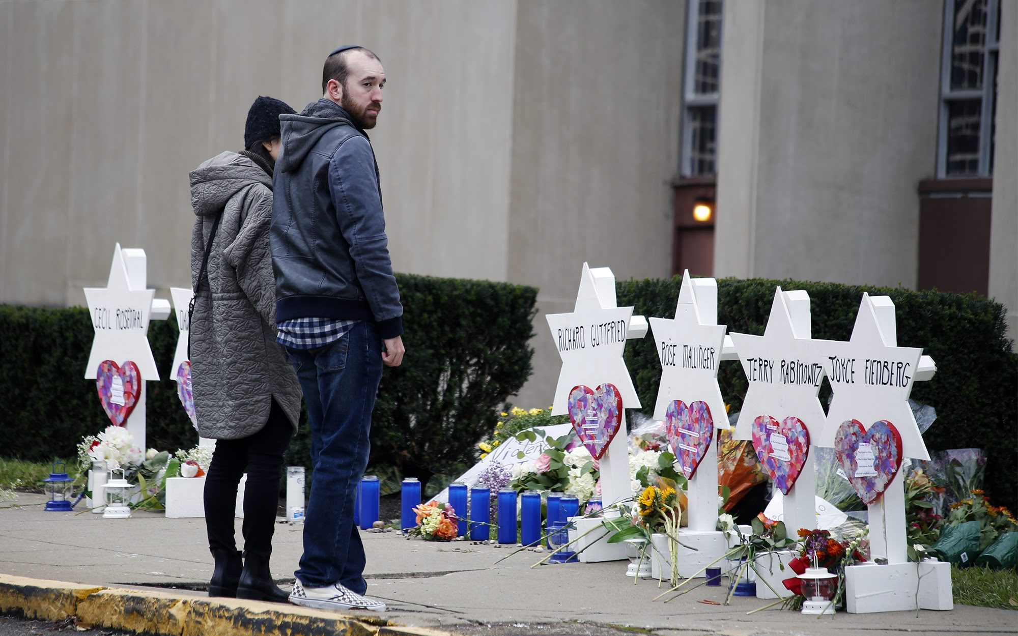 People visit a memorial site outside the Tree of Life synagogue in Squirrel Hill on Monday. (Photo by Ryan Loew/PublicSource)