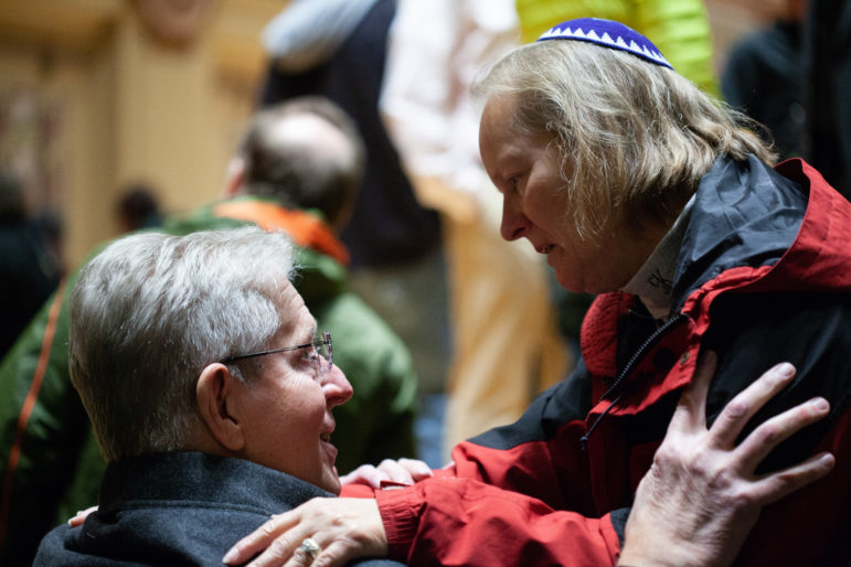 Rabbi Cheryl Klein of the Dor Hadash Congregation, one of three congregations that share the Tree of Life Synagogue, speaks with a congregant inside the Soldiers & Sailors Memorial Hall and Museum.