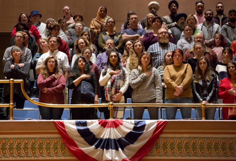 Inside the Soldiers & Sailors Memorial Hall and Museum, people gathered on Sunday evening to honor the victims of the synagogue shooting in Squirrel Hill.