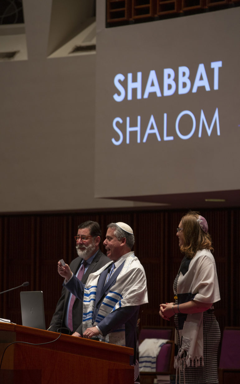 Pittsburgh Mayor Bill Peduto joined Rabbi Jamie Gibson and Associate Rabbi Karen Gorban at the commencement of Temple Sinai's Solidarity Shabbat service. (Photo by Heather Mull for PublicSource)