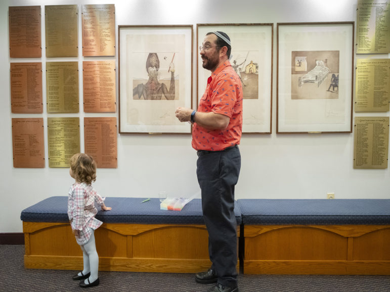In the lobby of Temple Sinai during Solidarity Shabbat services. (Photo by Heather Mull for PublicSource)