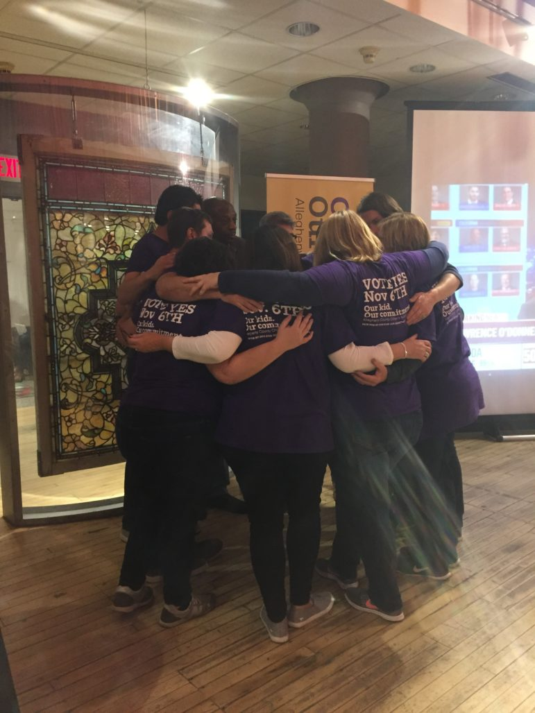 A group that helped to run the children's fund campaign huddle at Children's Museum in the North Side of Pittsburgh after the loss on Tuesday night. (Photo by J. Dale Shoemaker/PublicSource)