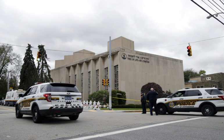 On Oct. 27 a gunman opened fire inside the Tree of Life synagogue in Squirrel Hill, killing 11 people and injuring six others, four of whom were police officers. It is believed to be the deadliest attack against Jews in U.S. history. (Photo by Ryan Loew/PublicSource)