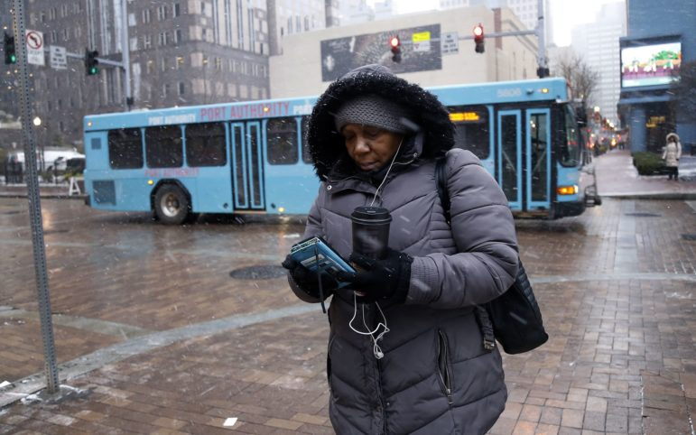 Alandia Heard waits for a bus downtown on the morning of Nov. 28. (Photo by Ryan Loew/PublicSource)