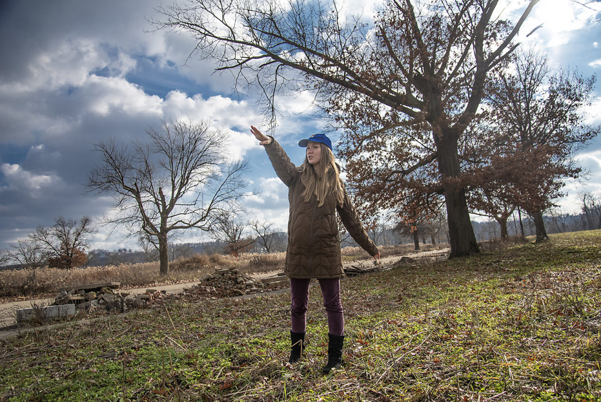 Sarah Baxendell, director of the Hilltop Urban Farm, points to the land set aside for (Photo by Teake Zuidema/PublicSource)