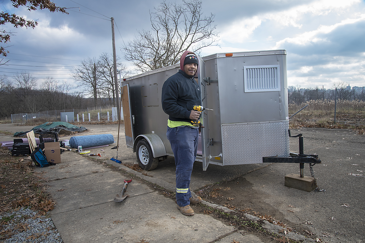Rakeem Collins, an employee of DECO Resources, is building a mobile cooler to transport produce from the Hilltop Urban Farm to sell to residents. (Photo by Teake Zuidema/PublicSource)