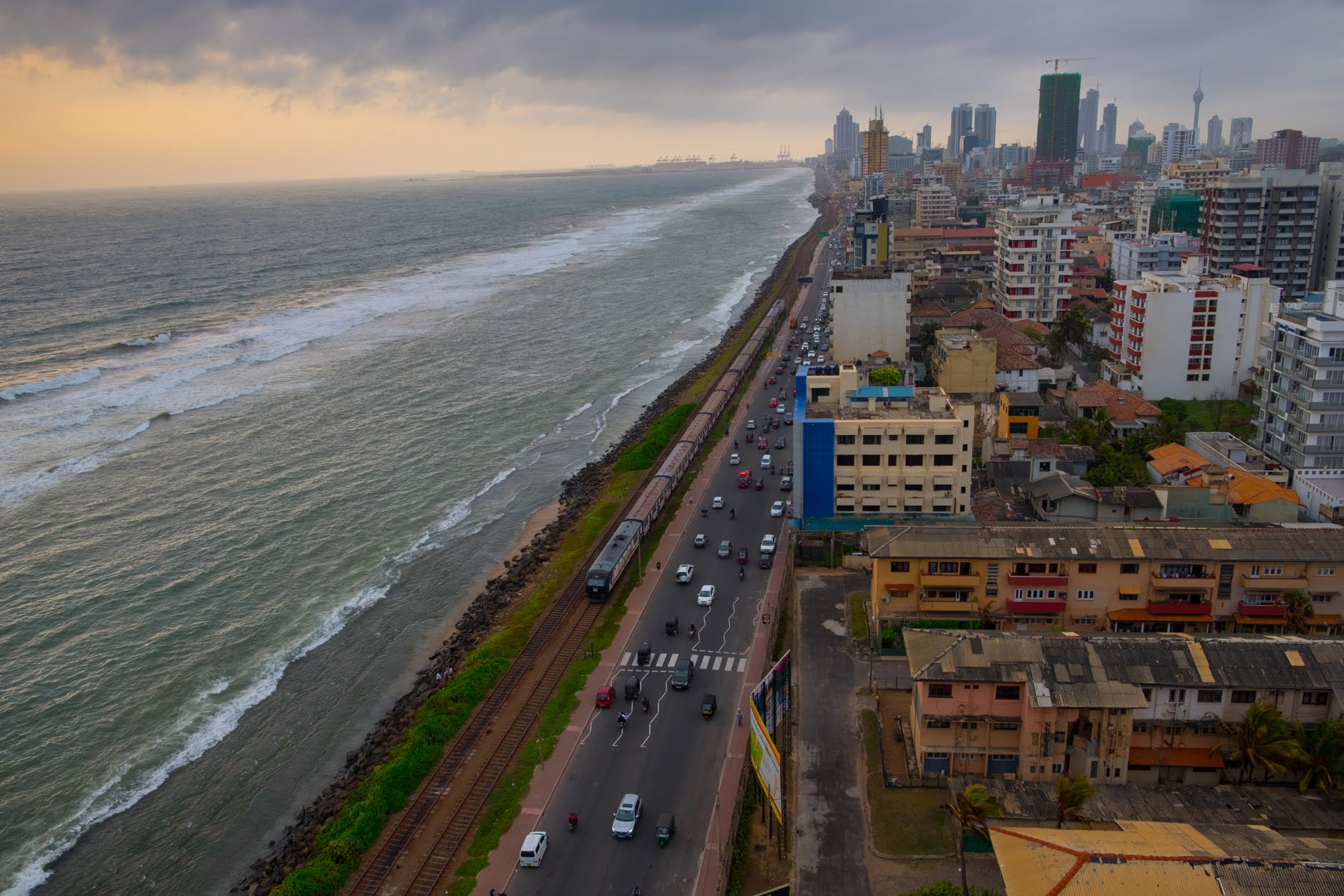 The busy view looking north upon Colombo Plan Road along the Indian Ocean towards the Bambalapitiya Railway station in Sri Lanka's capital city Colombo. Hiruni's parents both grew up and met in Colombo, which is being quickly redeveloped as Sri Lanka's economy improves in the decade since its 25 year civil war ended.
